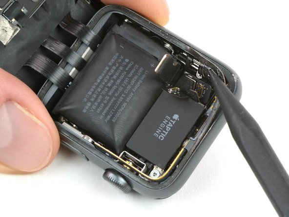 Lift up the connector plate of the Force Touch gasket.
