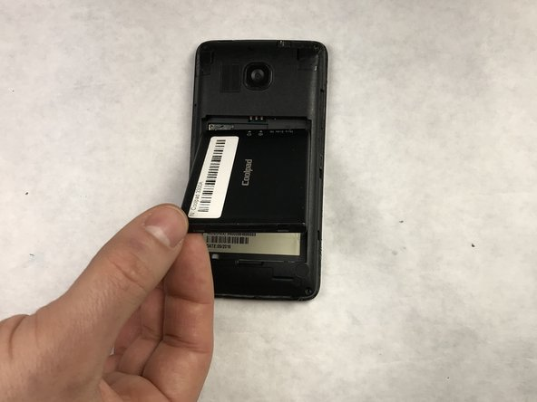 After removing the back of the phone (not pictured), remove the battery by lifting up from the bottom with your thumb. There will be a groove that allows you to remove the battery with your thumb.