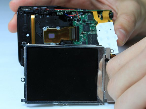 Holding the outer frame of the LCD screen, gently lift the LCD screen for replacement.