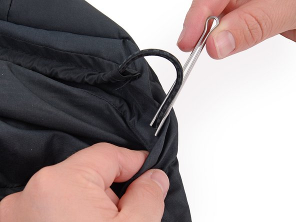In this case, the drawstring hold is a small hole in the garment. The drawstring hold is just the place where the drawstring will be sewn to the garment. This may vary from garment to garment.
