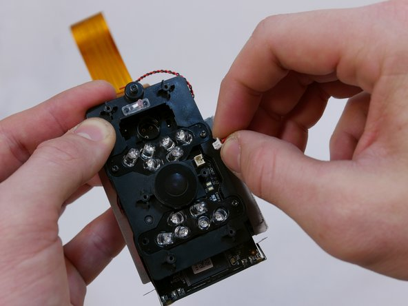 Locate the power connector next to the lens protector on the infrared LED board. Using your fingers, wiggle the power connector back and forth until it is loose.