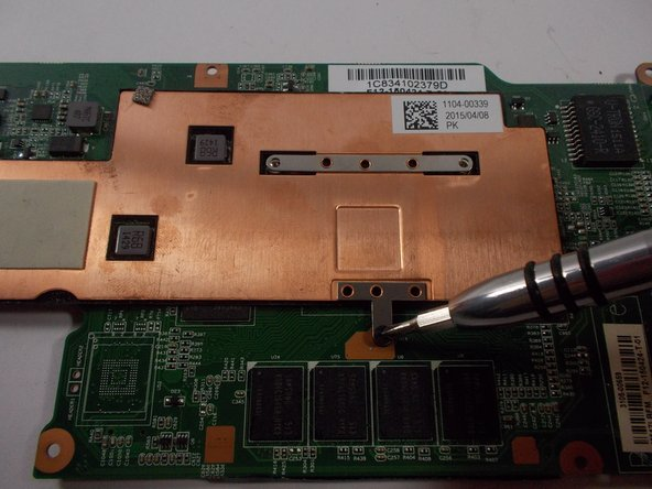 Image 2/2: Using a size 0 Phillips screwdriver, remove the three 2mm screws.