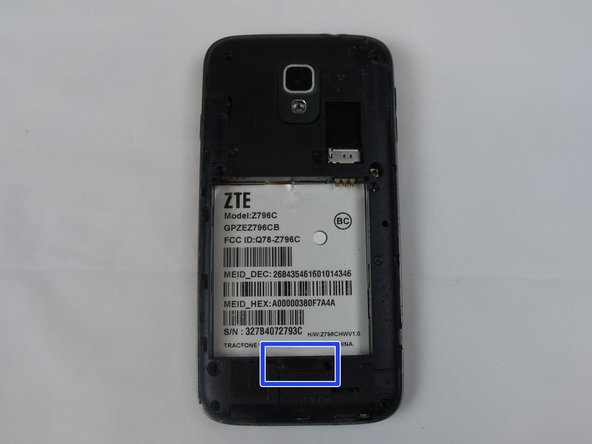 Now that the back is open, with your finger pry the battery out of the groove in the phone.