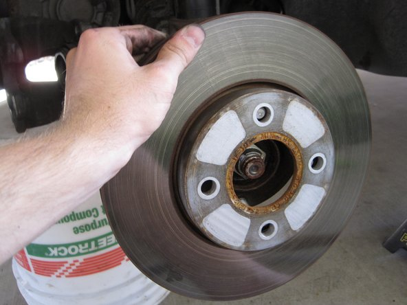 Remove the brake rotor by pulling it straight off the lugs.
