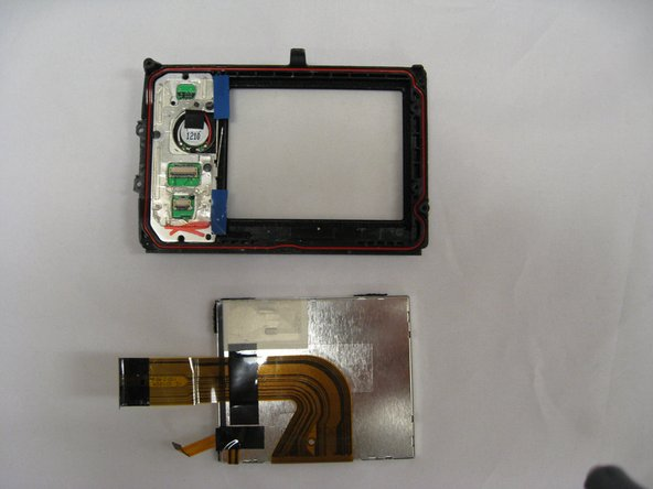 Using the spudger, gently pry the two screw holders from the LCD screen case.
