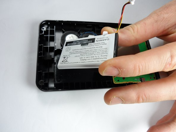 You may need to apply a considerate amount of force to remove the  battery from the GPS because an adhesive secures the battery to the rear case.