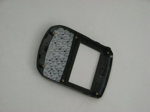 After removing the faceplate of the BlackBerry, place it facing down on a table as shown.