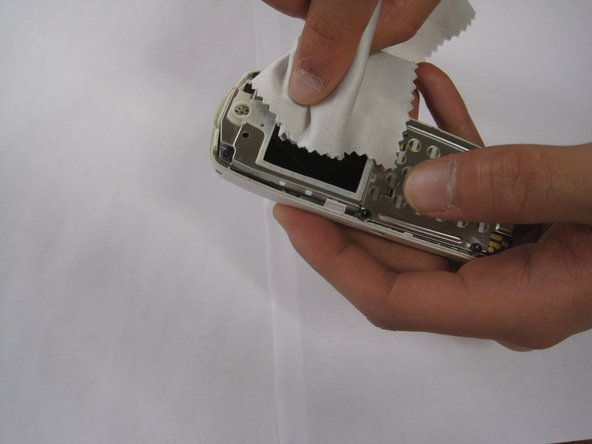 Image 1/1: Once the screen is exposed, spray cleaning solution onto a soft cloth and wipe the screen.