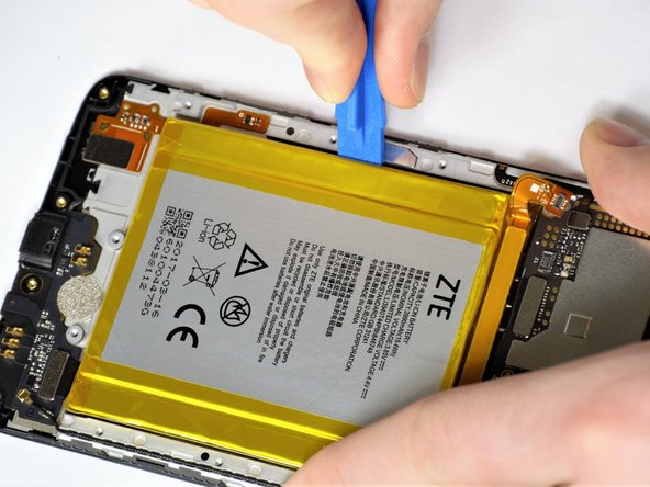 While prying, take care to not scrape the wires underneath the battery.