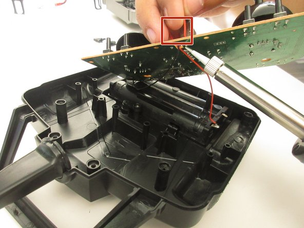 Gently lift up the circuit board from the black case.