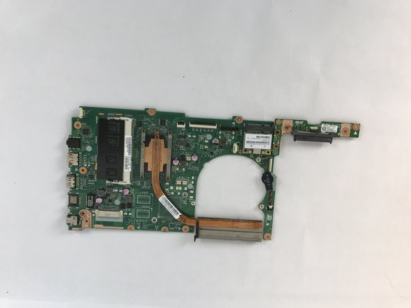 Carefully remove the motherboard.