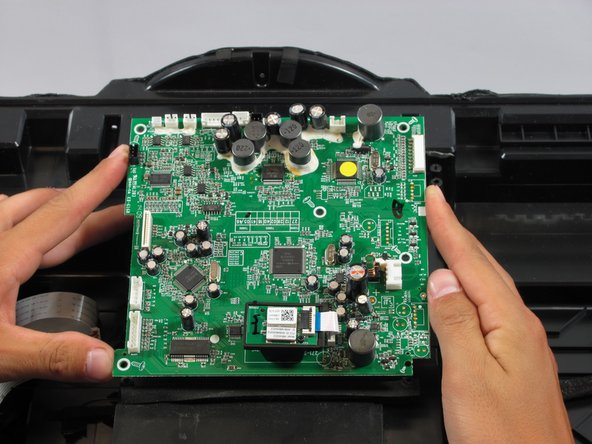 Gently lift the motherboard from its compartment