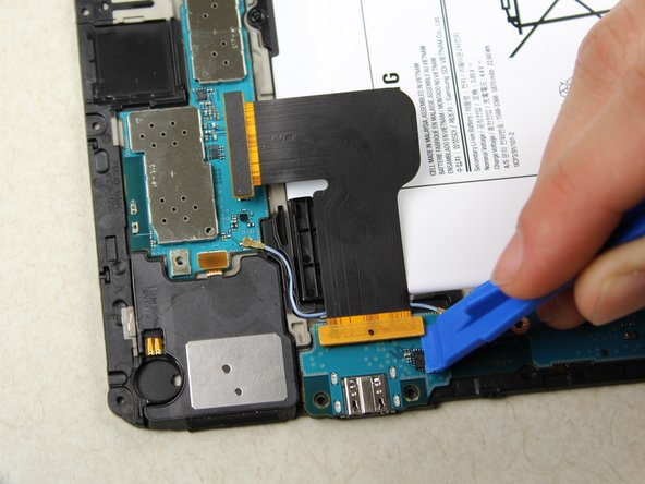 Using the tweezers, gently pull the cable off of the motherboard.