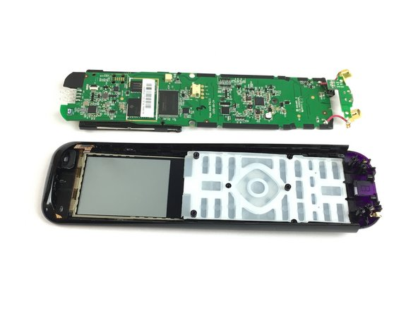 Pull the circuit board off of the remote from the bottom, and lift up to detach it from the cover.