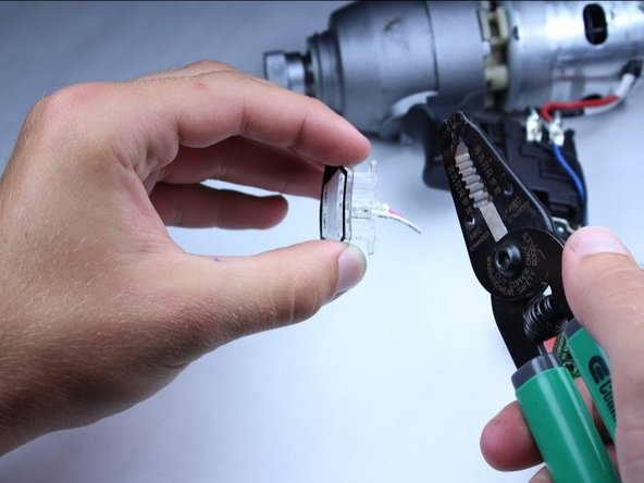 Cut the pink and white wire attached to the LED as a little more than a quarter inch from the LED.