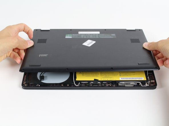 Carefully separate back panel from laptop.