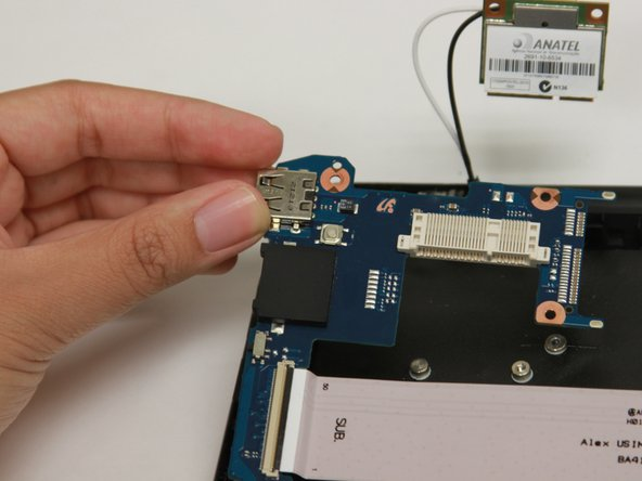 Gently lift the top left corner of the RAM and pull upward to remove it from the Chromebook.