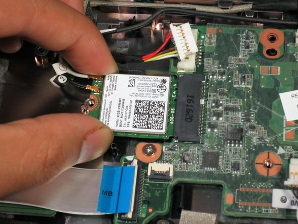 Slide the Wi-Fi card away from the motherboard.