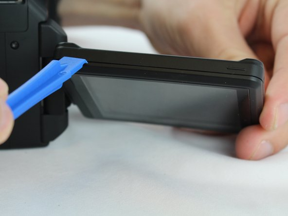 Use an opening tool to pry apart the LCD screen casing and remove the casing.