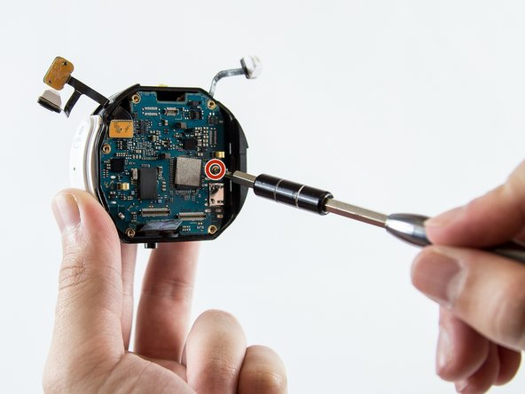Using a PH000 Screwdriver head, unscrew the Phillips #000 0.5 mm screw connected to the motherboard.
