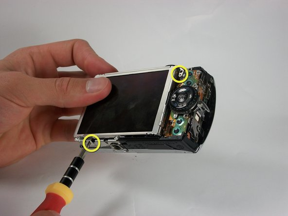 Remove the screws(2.88mm) at the top right corner and bottom left corner of the LCD screen.