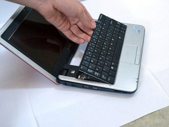 Lift up the keyboard using your fingers or a plastic opening tool