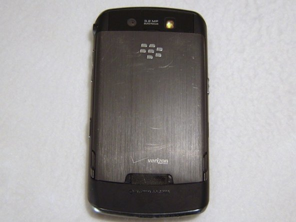 Turn your Blackberry Storm 9500 onto its back side, and remove the battery door & battery.