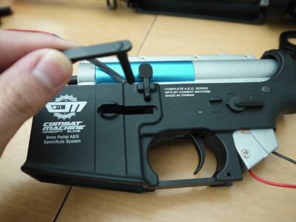 Pull the mag catch out from the other side.