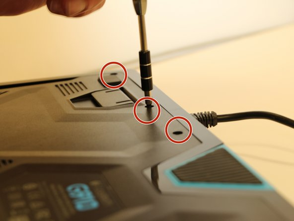 Turn over the keyboard and remove the three screws using a Phillips #0 screwdriver.