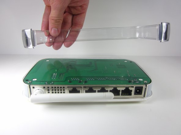 Remove the clear plastic casing by lifting it straight up from the router.