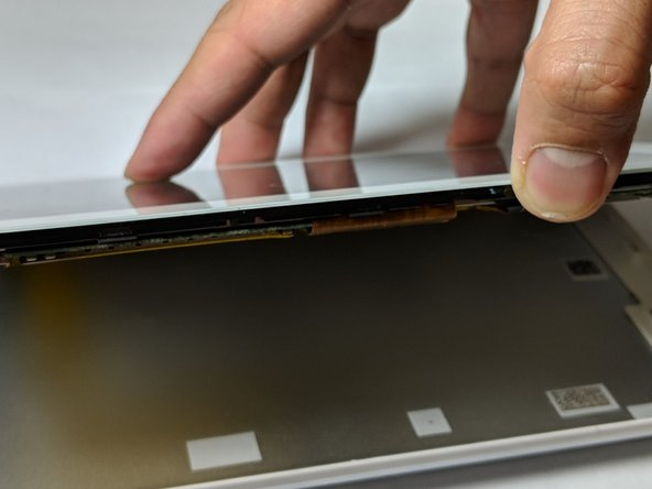 Continue sliding the plastic opening tool around the tablet until the cover fully separates from the device.