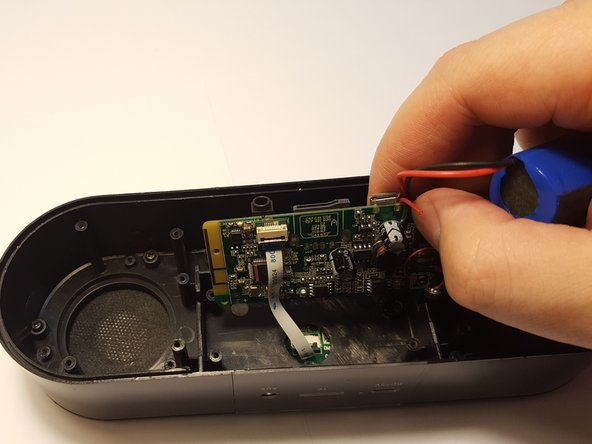 Image 2/2: You will have to be mindful that the battery and both speakers are connected to the motherboard and will need to be removed before replacing the motherboard.