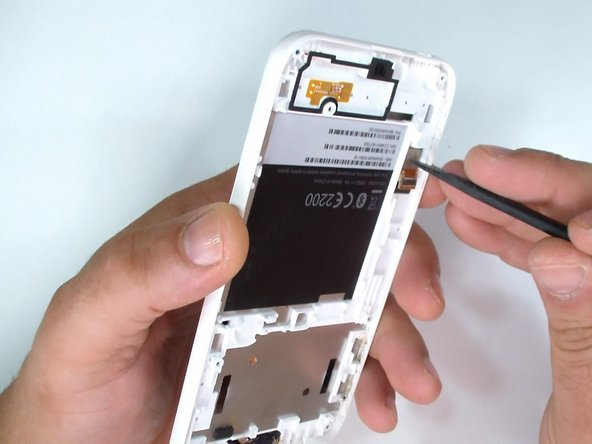 If you have a broken LCD display, use a plastic tool and remove it from the middle frame.