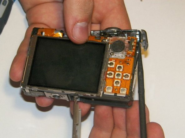 The power and shutter buttons are located on the top of the camera and are removed as a single unit.