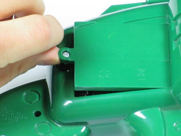 Image 2/2: Lift the cover away from the gun and remove.