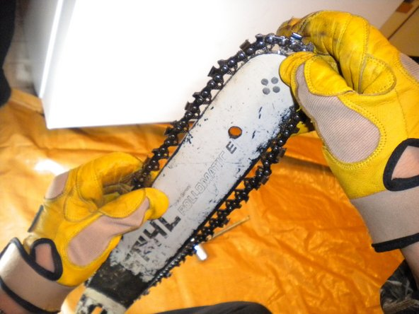 Make sure the chain is positioned correctly.  If you are looking at the top of the saw, the chain rotates away from the operator.