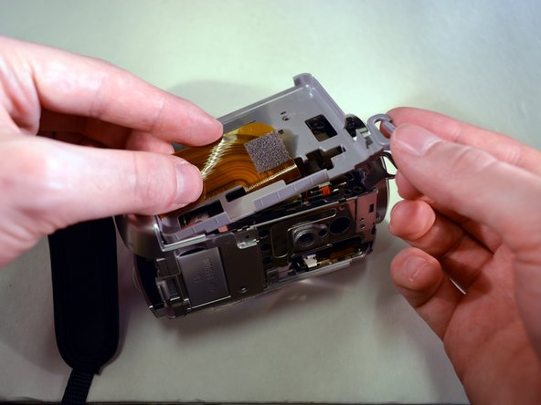 Image 2/2: The grey HDD tray, on the right side of the Handycam, is now free.