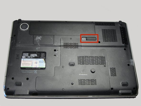 Image 1/3: Using your thumb, slide it all the way to the left until the front of the battery lifts up.