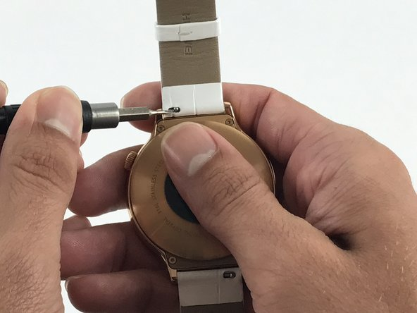 Use the Flex Extension to push the spring to the right. This will release the strap from the watch head.