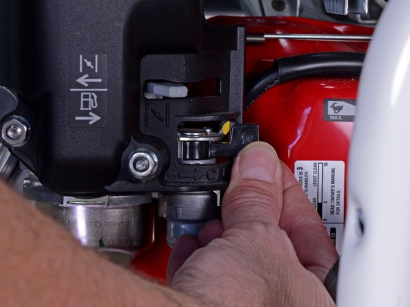 Locate the gas cutoff valve and flip the switch to the left to shut it.