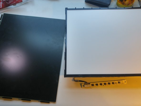 Image 3/3: Holding the screen vertically, slide the black screen off