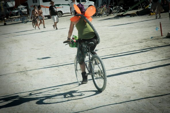 Someone riding a Yellow Bike at Burning Man