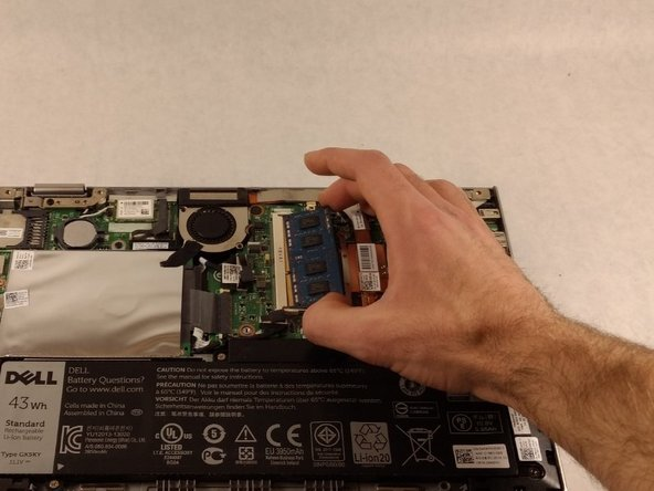 The RAM chip will pop up out of the slot.