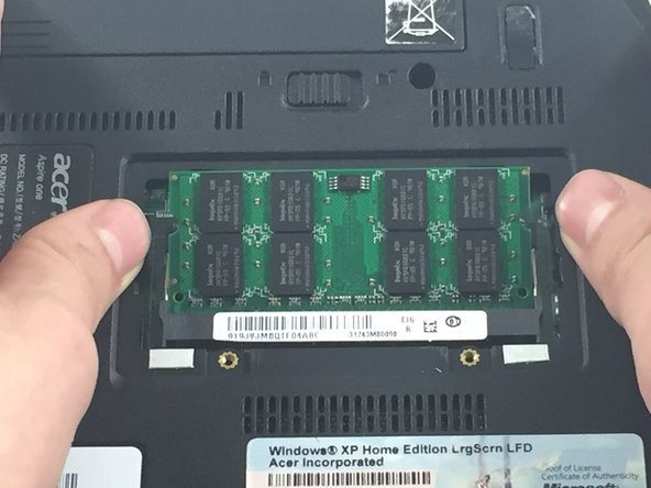 Use your thumbs to push the RAM clips out. The card should lift up when its released. It can then be removed.