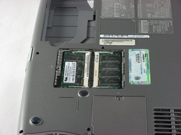 Remove the single screw securing the RAM compartment and pull up to reveal the RAM.