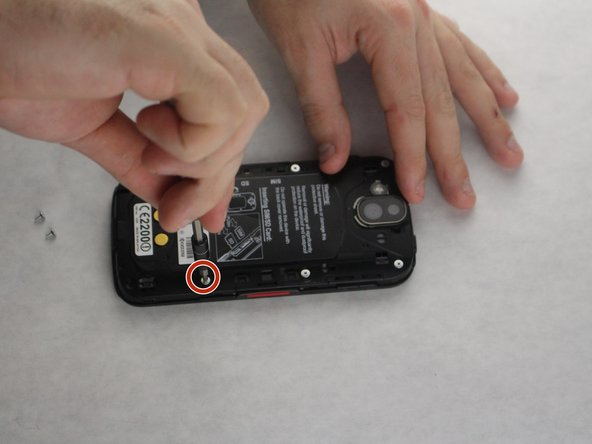 Remove the 8 screws around  the outer portion of the phone with the JIS #0 screwdriver bit.