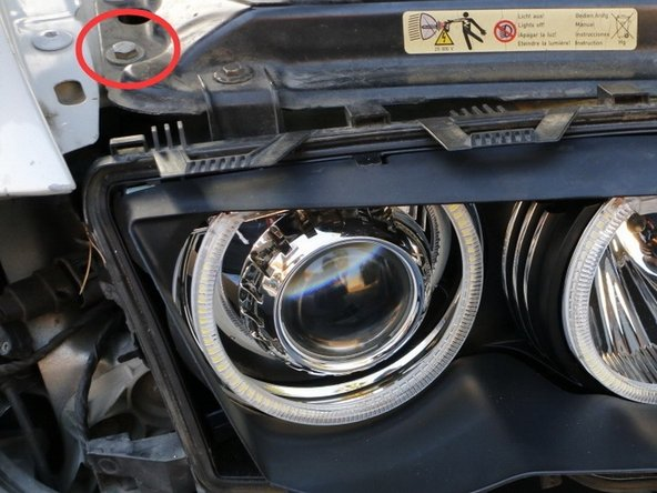Tap the black wire to the bolt circled in red.