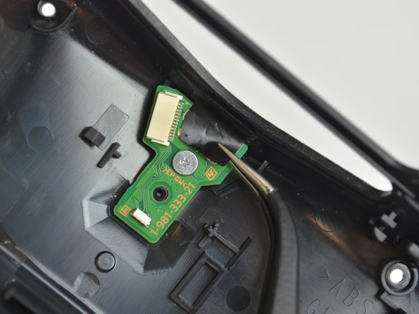 Peel off the black sticker on the charge port, using a pair of tweezers.