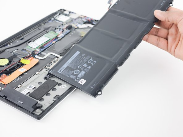 There's some tape over the battery so we peel it off before removing the four screws securing it to the lower case.