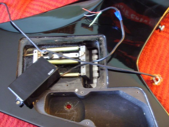 "After you cut them, just pull them out. You have to remove the outputjack-screws, the pickup and the poti. Then you've got a ""naked"" guitar."